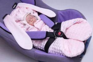 Как закрепить новорожденного в автокресле зимой